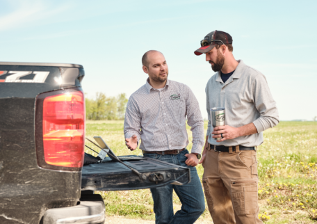 Image of farmer and agronomist in field