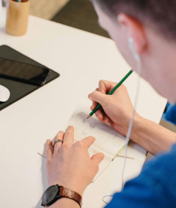 male designer sketching at desk