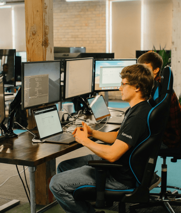 two male developers sitting at a desk working