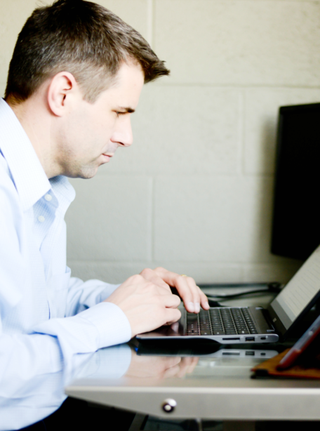Man researching ag-industry software on a laptop